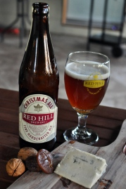 Red Hill Christmas Ale beer next to blue cheese, figs and walnuts