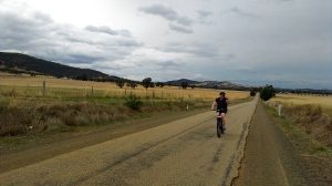 A long stretch of country road with a long rider