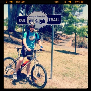 James on bike at the Beechworth entry to the Murray To Mountains Rail Trail
