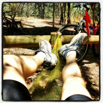 View of legs on a hammock beside the rail trail