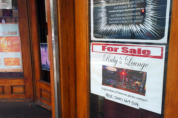 A For Sale sign on the entry door to Ruby's Lounge