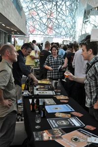 A brewer talks to punters at a tasting event