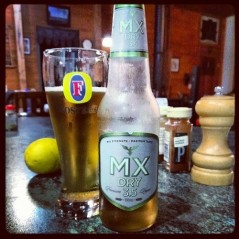 A bottle of MX Dry 3.5 beer