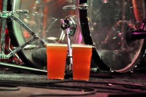 2 pints of the Front End Load beer next to the drum kit at Cherry bar