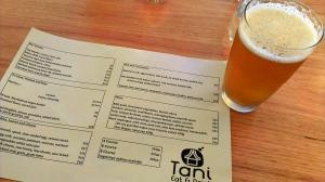 The menu and a beer at Tani Eat & Drink