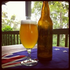 A glass and bottle of Boxing Day Test Batch on an Australian flag