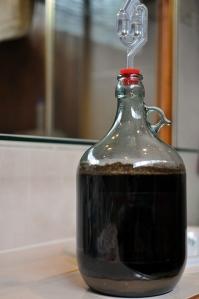 A full BrewSmith glass fermenter