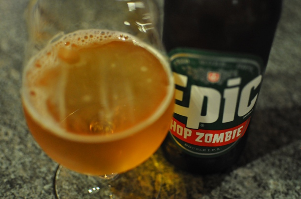 A glass and bottle of Epic Hop Zombie viewed from above.