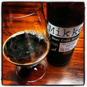 A  bottle and glass of Mikkeller Beer Geek Brunch Islay