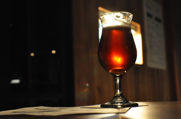 Shiny red beer in a tulip glass