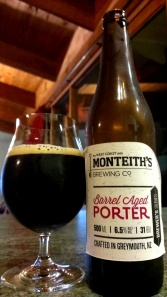A full glass and a bottle of Monteiths Barrel Aged Porter