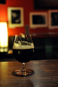 A dark beer in a tulip glass