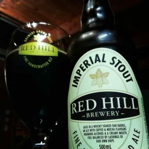 A bottle and glass of Red Hill whisky barrel aged imperial stout