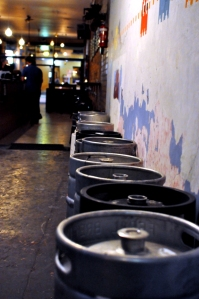 Kegs lining a wall at The Alehouse