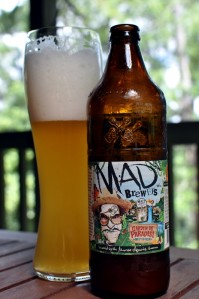 A glass and bottle of Mad Brewers Garden de Paradisi