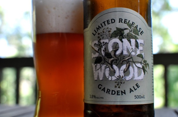 A closeup of a full glass and pint bottle of Stone and Wood Garden Ale