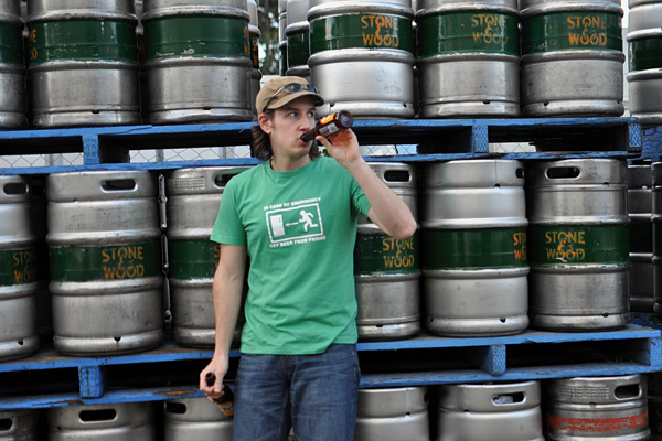 James drinks Pacific Ale standing in front of Stone & Wood kegs