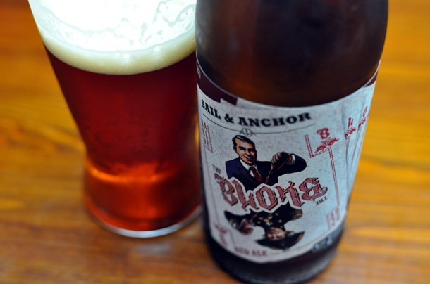A full glass and a bottle of Sail and Anchor The Bloke red ale.